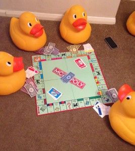 Bid ducks playing monopoly
